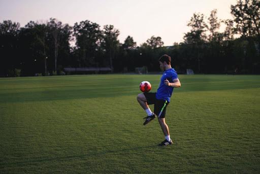 man juggling a ball