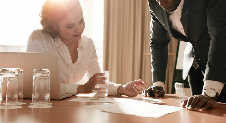 bigstock-Businesspeople-Working-On-New--108468671